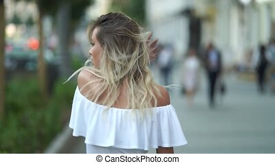 Charming young woman with a magnificent golden hair,...