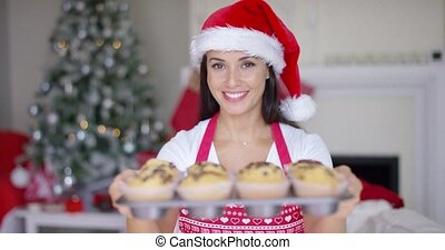 Charming young woman with fresh baked muffins