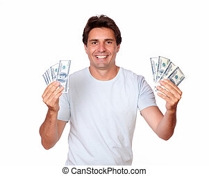 Charmismatic hispanic adult holding cash money