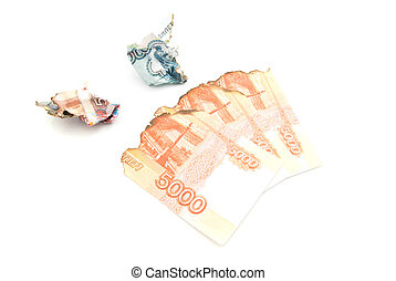 charred russian banknotes on white background closeup