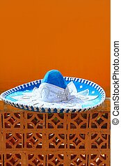 charro mariachi blue mexican hat detail over orange...