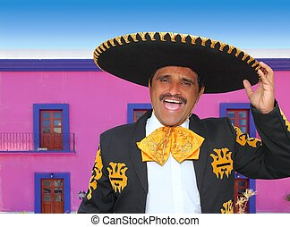 Charro mariachi portrait singing in mexican house