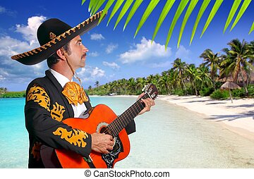 Charro mexican Mariachi playing guitar in beach