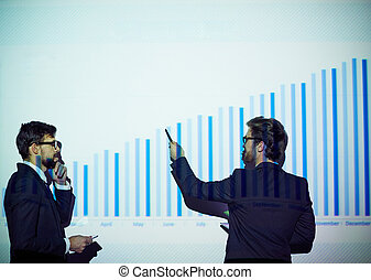 Chart of progress - Young businessman presenting his...