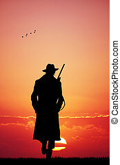 chasseur, coucher soleil