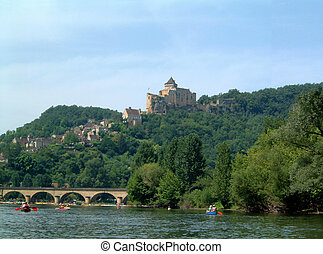 Canoeing on the Dordogne with Chateau in the background