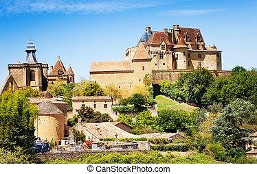Chateau de Biron ensemble in summer, France