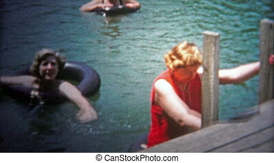 CHATTANOOGA, USA - 1954: Women swimming in lake