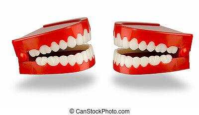 Chatter - A pair of toy chattering teeth isolated on a white...