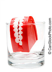 Chattering Teeth - A set of chattering teeth in a glass.