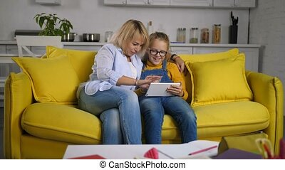 Chatting mom and daughter networking with tablet pc