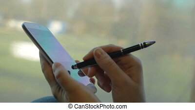 Chatting on smart phone during train ride - Close-up shot of...