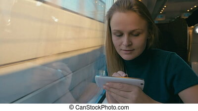 Chatting on the phone during train journey