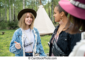 Chatting with friends at campsite - Pretty blond-haired girl...