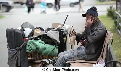 Chatty man in dirty clothes talking on the mobile phone