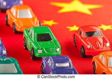 Several miniature Chinese cars on Chinese flag (2)