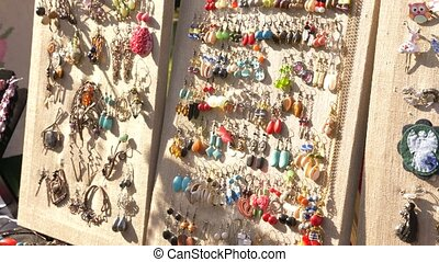 Cheap jewelry on the open market. products from semiprecious...
