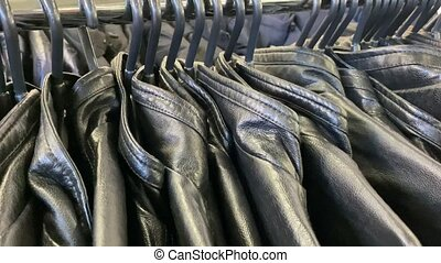 Cheap leather jackets in the store. Jackets are hanging for ...