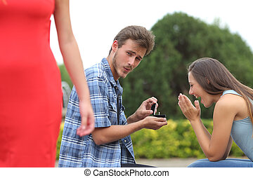 Cheater man cheating during a marriage proposal