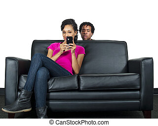 Cheating Spouse - man snooping on girlfriends text messages