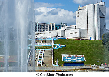 Cheboksary, Chuvashia/ Russia - August 24 2019: View through the fountain to the stairs at the Opera and Ballet Theater on the day of the celebration of the 550th anniversary of the city of Cheboksary in 2019.
