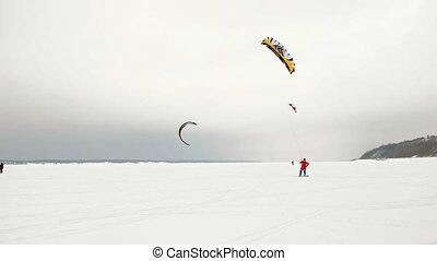 CHEBOKSARY, RUSSIA - DECEMBER 31, 2018: snowkiting athletes...