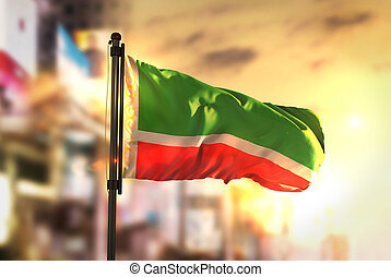 Chechen Republic Flag Against City Blurred Background At...