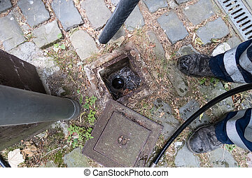 There is a sewer system in the ground that needs to be checked to make sure there are no blockages.