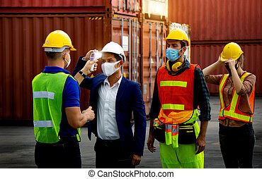 Check body temperature Before working in the warehouse To prevent the spread of covid-19