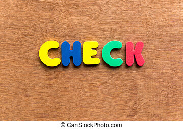 check colorful word on the wooden background