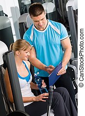 Check fitness exercise plan with personal trainer