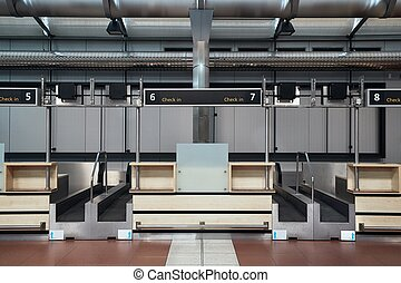 Check-in counters and baggage conveyors at an airport