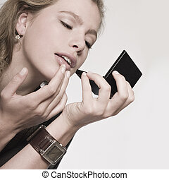 Check my lips - Portrait of a beautiful blond model checking...