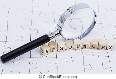 """White puzzle with magnifier and letters """"resources"""""""