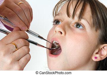 Check-up - Young girl having a dental check-up