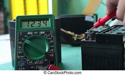 Check Volt Battery with digital multimeter