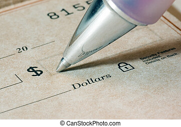 Check Writing - Close-up of a person filling out a dollar...