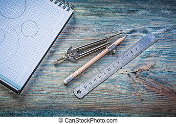 Checked copybook ruler divider pencil on vintage wood board