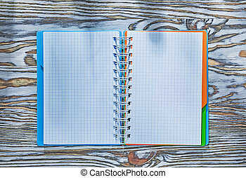 Checked notepad on wooden board
