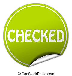 checked round green sticker on white background