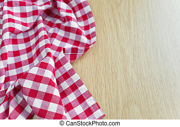 Checked tablecloth is on the wooden table