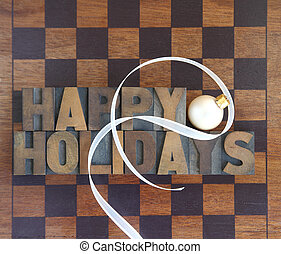 checkerboard with happy holidays