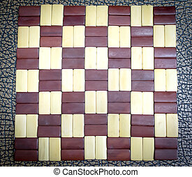 Checkerboard wooden pattern with brown