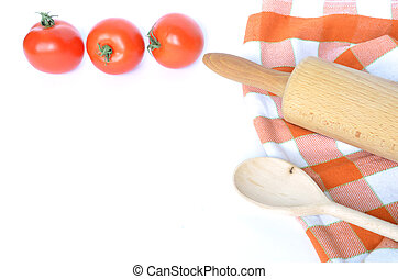 Checkered dishcloth, spoon, tomatoes and rolling pin isolated on white