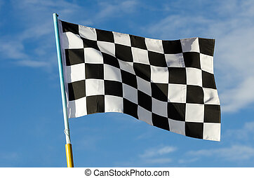 Checkered flag with blue sky on background