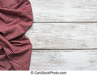 Checkered napkin on a wooden background