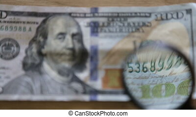 Checking a bank note - One hundred dollars,full hd video