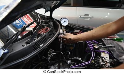 Checking a car engine for repair at car garage - Bangkok,...