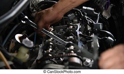 Checking a car engine for repair at car garage - Bangkok,...
