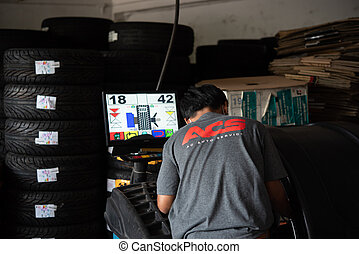 Checking a car wheel, tire repair at car garage
